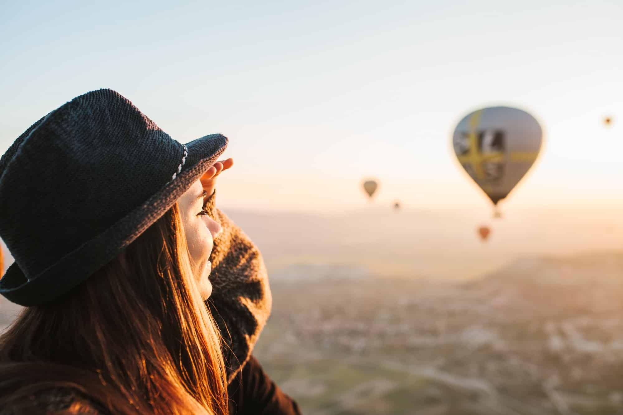 Girl enjoys hot air balloon flight